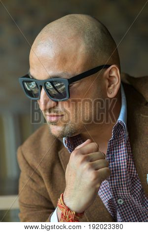 portrait of a hansome indian businessman in sunglasses, serious and confident man.