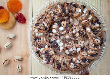 Israeli walnut cookies sweet made with honey and pistachio nuts. Horizontal rustic style. Wooden background. Close-up. Top view