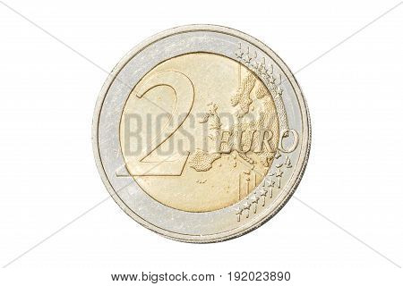 Coin of two euro closeup with European map symbol of United Europe. Isolated on white studio background.