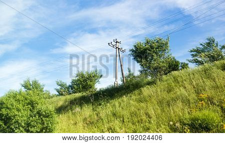 Electric pole with wires on spring nature