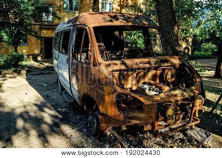 Burnt after fire rusty minibus in Voronezh
