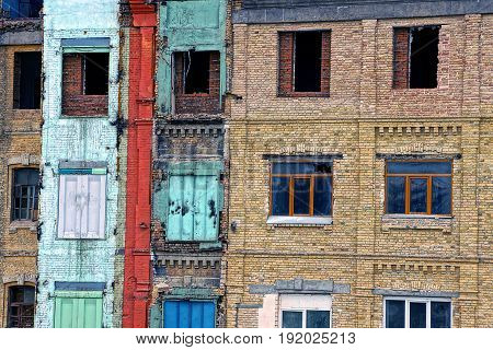 Windows with broken glass not the wall of a multi-storey brick house