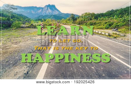 Inspirational Typographic Quote-Learn to let go, that is the key to happiness,with blur road,tropical jungle,mountain and a path background retro style.