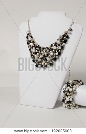 Beautiful black and white necklace and bracelet on a mannequin