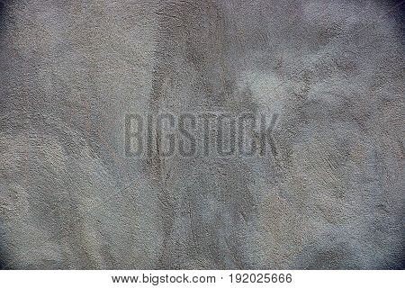 Gray background of part of a concrete wall of a private building