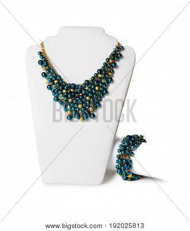 Beautiful navy blue necklace on a mannequin in front of white background