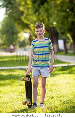 Boy in crouched position riding a skateboard at the park