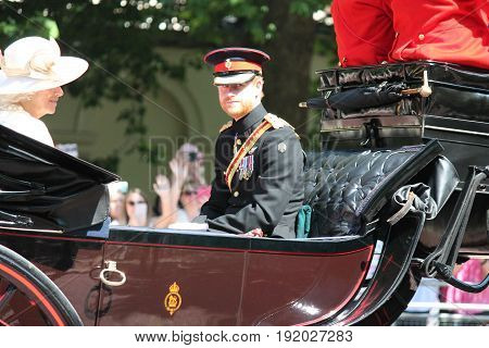 London, England - June 17, 2017: Prince Harry, Kate Middleton and Camilla Parker Bowles in an open carriage for trooping the colour 2015 to mark the Queens official birthday, London, UK.