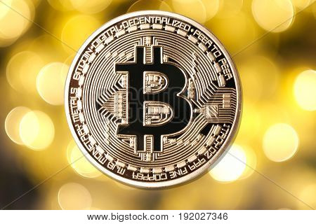 Golden Bitcoin Isolated On Blurred Light Background