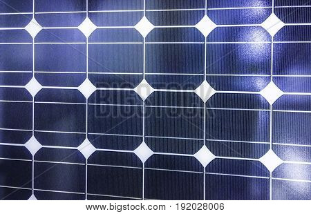 Closeup of blue photovoltaic solar panels background