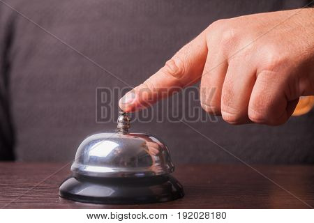 Close-up finger that presses of the service bell ring