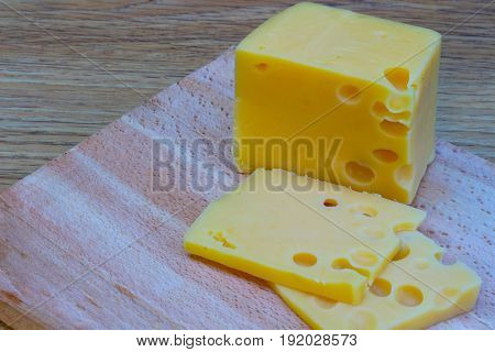 Cheese on wooden cutting board. Stock photo