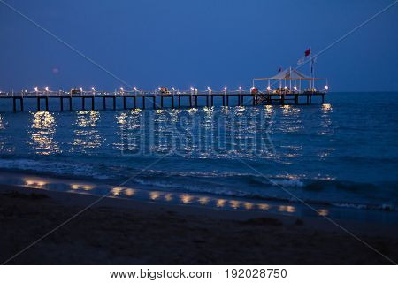 Beauty romantic pier with bright lightening during the beautiful summer night