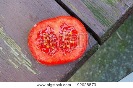 Fresh tomato on wooden table. Stock photo.