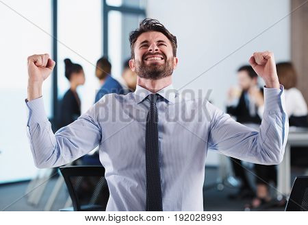 Successful businessman in office during a meeting with colleagues