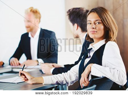 Confident businesswoman during a business meeting in office