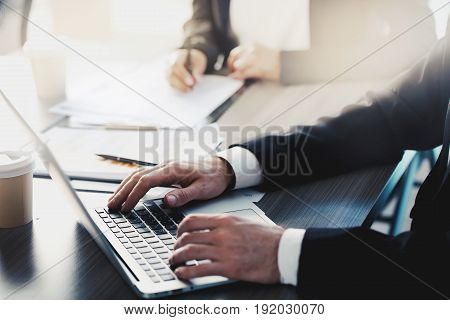 Businessman works with a laptop in office during a meeting