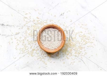 paella ingredients with rice on white kitchen table background top view mock up