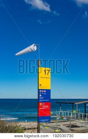 Windsock And Information Board. High Wind On The Beach