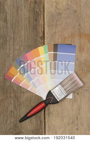 Overhead Shot Of Paintbrush And Various Color Paint Swatches
