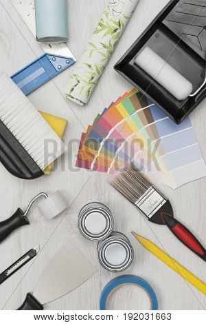 Painting Tools, Paint Swatches, And Wall Paper Roll Overhead