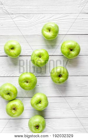 fitness food with fresh green apples on white background top view
