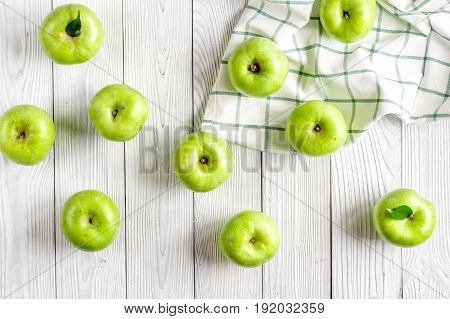 fitness food with fresh green apples and napkin on white background top view