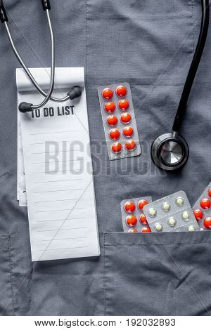 doctor's work desk in hospital with stethoscope on overall background top view mockup