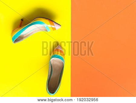 Collection of women's shoes on colourful background