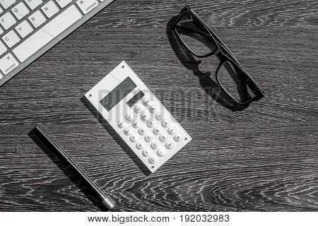 savings, finances and economy set for accountant or banker on dark wooden table background top view