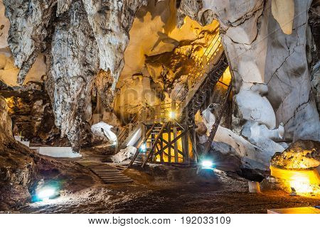 Inside Beautiful Cave with Stairway and Lighting