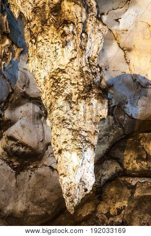 Huge Stalactite in Beautiful Natural Cave .