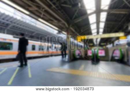Abstract blur of Shinjuku train station .