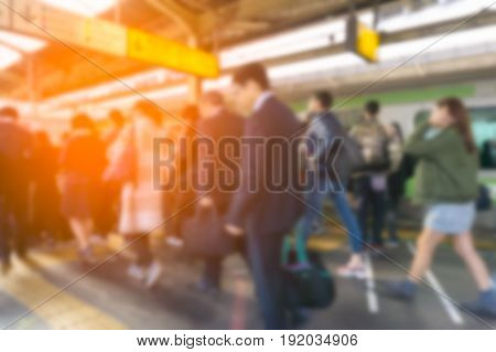 Abstract blur Shinjuku train station. with sun light .