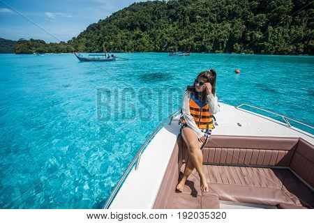 beautiful girl on the head speed boat and looking beautiful sea at Surin island thailand