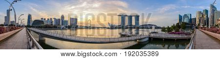 SINGAPORE CITY SINGAPORE : JUNE 32016: Panorama view of Singapore city skyline when sunrise at Marina Bay and Merlion Park Singapore