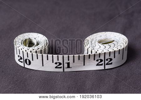 Inch, Centimeter Tape Tailor Folded In The Form Of Eight