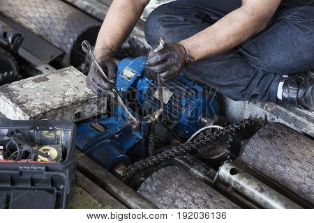 Hand Holding A Wrench And Tighten And During Maintenance Work Of Electric Motor