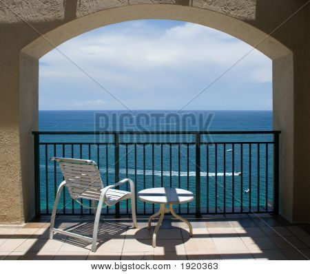 Chair And Table Under Arch