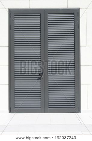 Mediterranean closed door lid with lock in sunny day