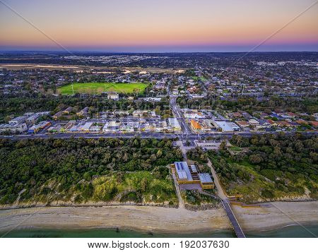 Aerial View Of Small Shopping Centre In Seaford And Nepean Highway At Dusk. Melbourne, Victoria, Aus