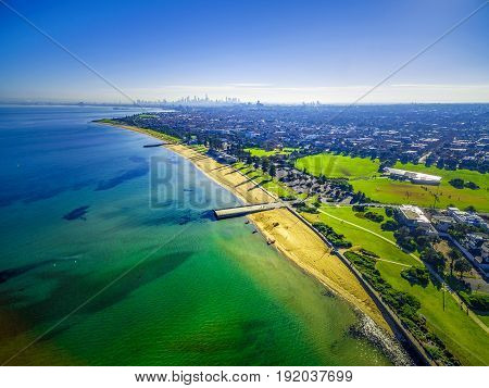 Aerial View Of Coastline Beaches Near Elwood With Melbourne Cbd Skyscrapers In The Distance On Brigh