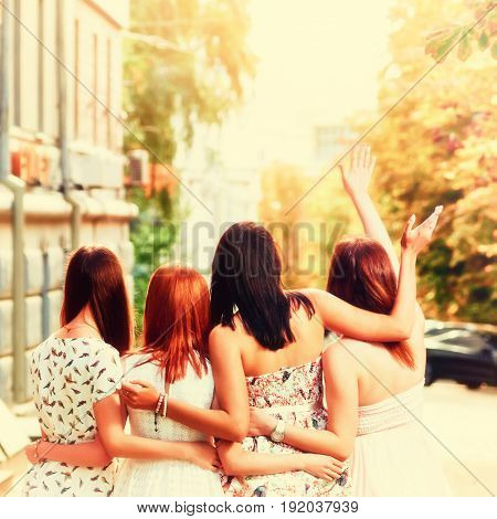 Back view of group young best girlfriends hugging outdoors, A picture with toning and a square relation of the sides