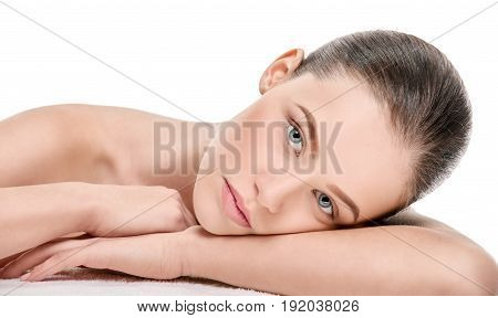 Relaxed beautiful woman resting after spa and lying on hands