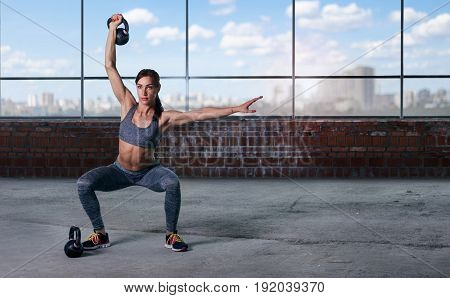 Woman athlete training with weights. Copy space. Sport background