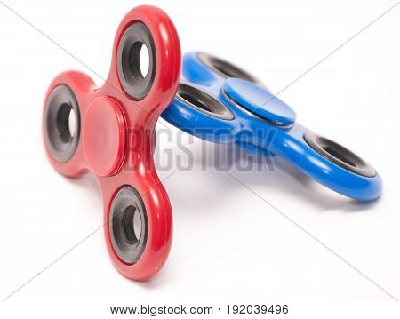 Red and blue fidget spinners with a white background