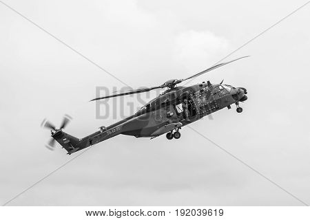 BERLIN GERMANY - JUNI 01 2016: Flight helicopter NH90 of the German Army. Black and white. Exhibition ILA Berlin Air Show 2016