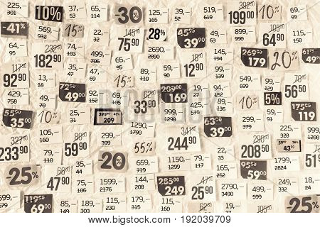 DISCOUNTS sepia background of cut paper figures.