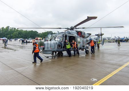 BERLIN GERMANY - JUNE 01 2016: An anti-submarine and anti-shipping helicopter - AgustaWestland AW159 Wildcat. Black Cats (Royal Navy Display Team). Exhibition ILA Berlin Air Show 2016