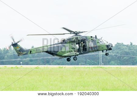 BERLIN GERMANY - JUNE 01 2016: Landing helicopter NH90 of the German Army. Demonstrative performance. Exhibition ILA Berlin Air Show 2016